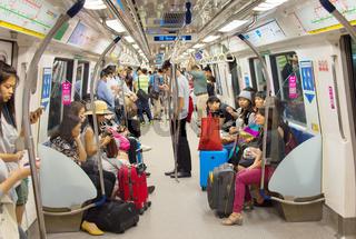 People inside metro train. Singapore