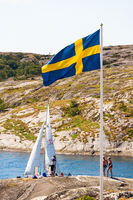Swedish flag in a bathing area by the sea