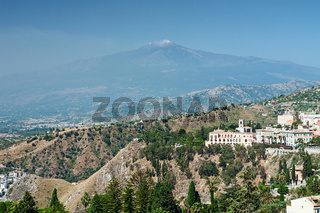 View of a part of Taormina city and the Etna volcano, Sicily, Italy