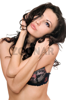 Portrait of playful beautiful brunette. Isolated on white background