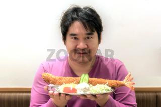 man hold Japanese food ebi katsu deep fried shrimp