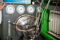close-up high pressure diesel fuel pump test bench