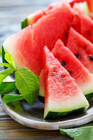 Dish with juicy watermelon on a metal tray.