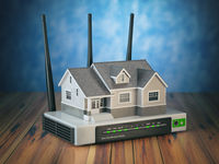 Home wireless network. House and wi-fi router on wooden table and blue background.