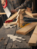 Joiner making a wooden Christmas decoration