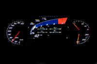 Modern light car mileage on black background 42 MPH