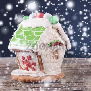 Gingerbread house on wooden background
