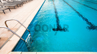 outdoor swimming pool with blue water