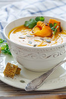 Pumpkin soup with chunks of baked pumpkin and spices.