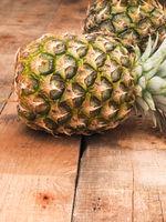 Organic pineapples on wood