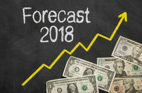 Text on blackboard with money - Forecast 2018