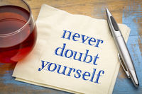 Never doubt yourself text on napkin