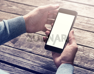 Smartphone in hands. Clipping path included.