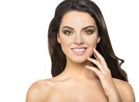 Beautiful smiling brunette on white background