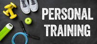 Fitness equipment on a dark background - Personal Training