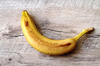 Banana on a wooden table.