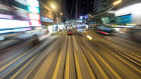 Double-decker tram on night road of Hong Kong