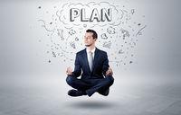 Businessman meditates with doodle concept
