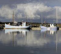 Sail boats anchored at the bay