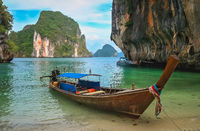 Tourist boat in a beautiful cove on thai coast