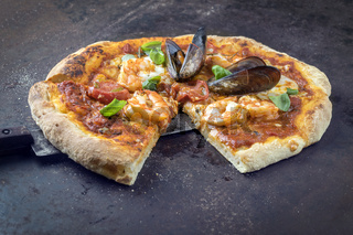 Seafood Pizza on old Metal Sheet