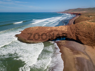 Legzira beach with arched rocks in Morocco