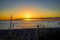 Sunset on Kaikoura beach, New Zealand