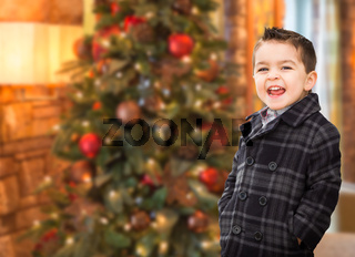 Handsome Mixed Race Caucasian and Hispanic Boy In Front of Christmas Tree.