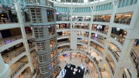 Multistorey shopping mall with customers