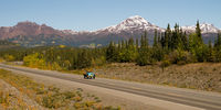 Vintage Car Travels North Highway Alaska Mountain Range Transportation