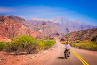 Man cycling on the empty road to Cafayate