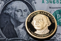 One dollar coin - George Washington - on one dollar banknote