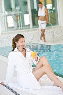 Swimming pool - young woman relax on poolside