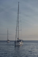 Yacht at Cala Saona in Formentera at sunset. Balearic Islands. Spain