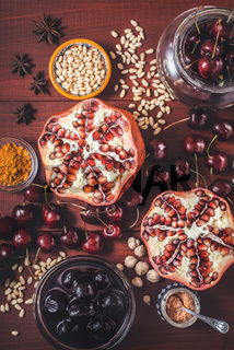 Different fruit and spices on the red wooden table. Concept of oriental fruits vertical