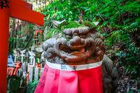 Lion statue at Fushimi Inari Taisha, Kyoto, Japan