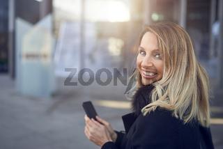 Smiling attractive woman looking over her shoulder