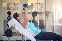 Attractive middle-aged woman working out in a gym