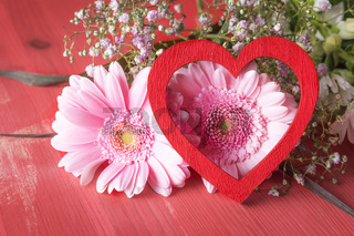 Pink flowers and red heart