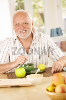 Portrait of older man having morning tea