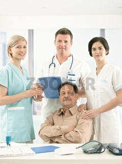 Portrait of senior patient and medical crew