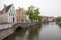 Scenic cityscape with Green canal,