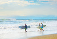 Surfers going surf, Bali island