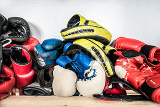 Set of worn boxing and kickboxing accessories: gloves, hand wraps, focus punch pad