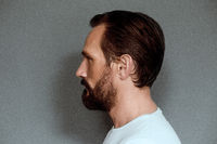 Face profile of mid aged man actor.