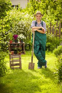 Garden gardener spade straw hat fence