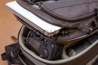 Laptop and Professional Photography Equipment in Protective Backpack