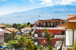cottages in Giardini Naxos town and view of Etna