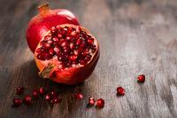 Pomegranate fruit on wooden vintage background
