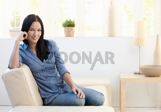 Portrait of attractive young woman on couch